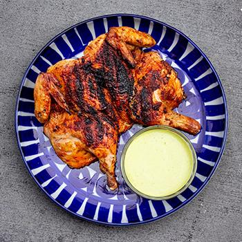 Whole grilled spatchcocked chicken