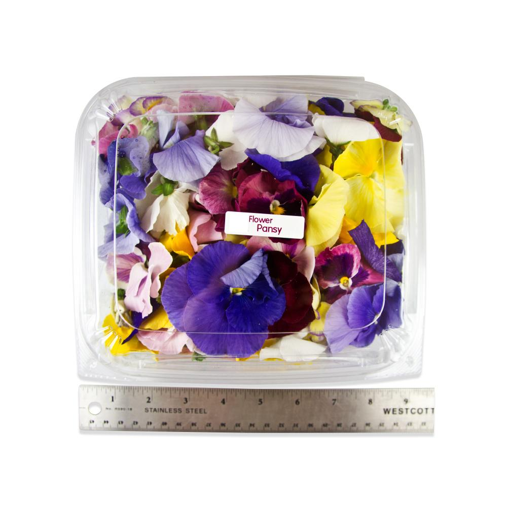several multi-colored fresh edible pansy blossoms in a clear plastic package