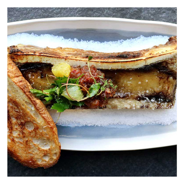Roasted canoe-cut marrow bone with toast & date jam