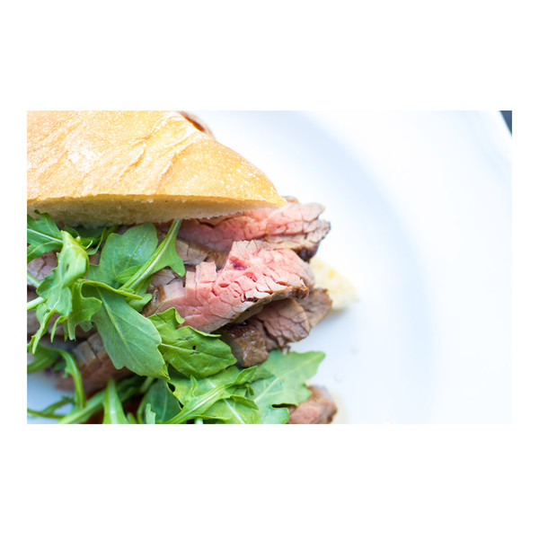 Flank steak sandwich with arugula on ciabatta bread