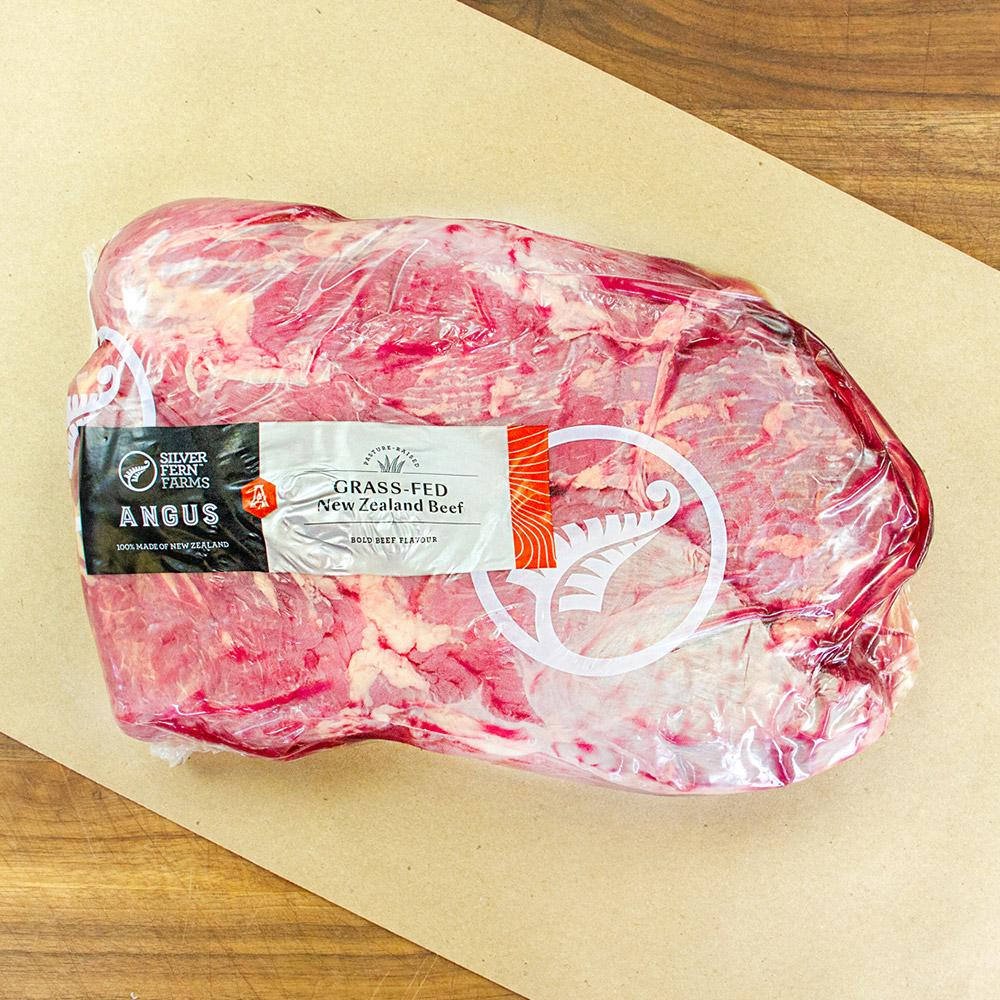 One raw grass-fed Angus beef tri tip from New Zealand in a vacuum sealed pack on butcher paper