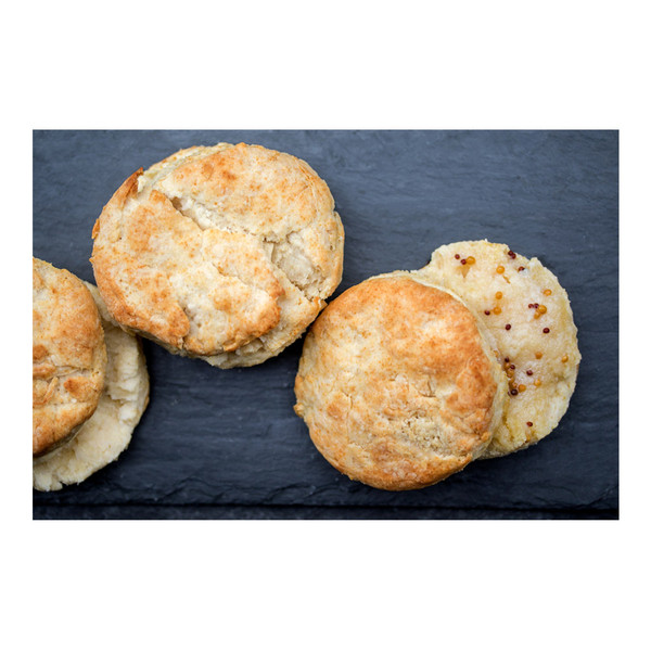 Three round split biscuits speckled with mustard seeds baked with Iberico pork back fat