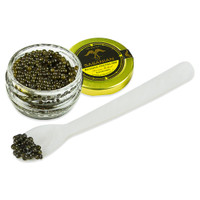 grains of caviar on the tip of a spoon next to an open jar of Russian Osetra 000 caviar