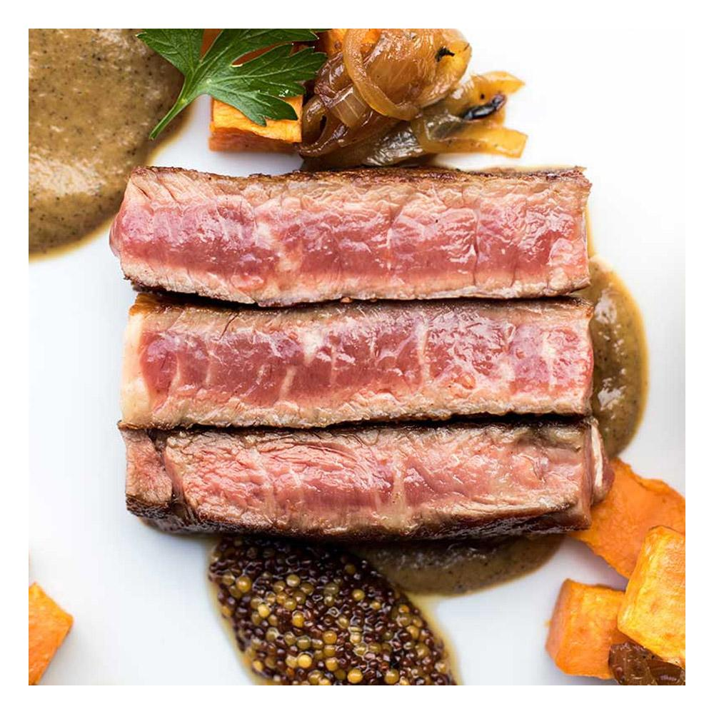 Cooked sliced Wagyu Ribeye with pickled mustard seeds, charred onion puree & sweet potato