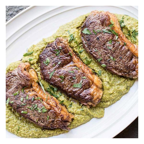 Cooked Wagyu Strip Steaks with green hazelnut romesco sauce