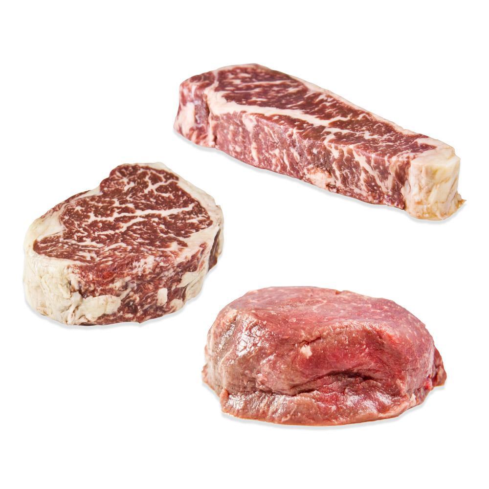 Raw strip steak, ribeye, and filet mignon from Wagyu Beef Sampler