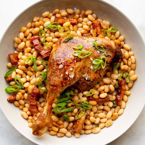 Magret Duck Leg confit over beans