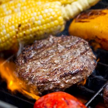 Burger and veggies on a grill