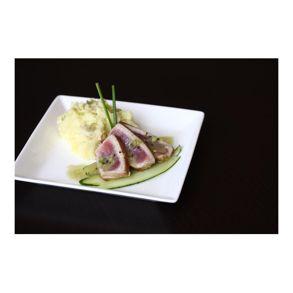 3 slices seared yellowfin ahi tuna, chopped green onion, wasabi vinaigrette, smashed potatoes & sliced cucumber
