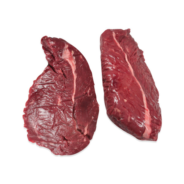 Two raw bison (buffalo) hanger steaks on a white background