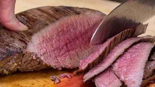 slicing venison on cutting board