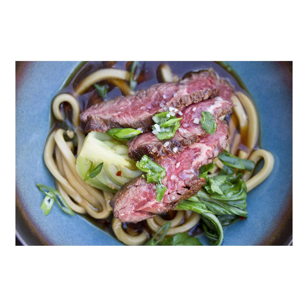 Noodles & grass-fed beef hanger steak in a gingery, umami-rich warming broth cut with cilantro and spicy chile flakes