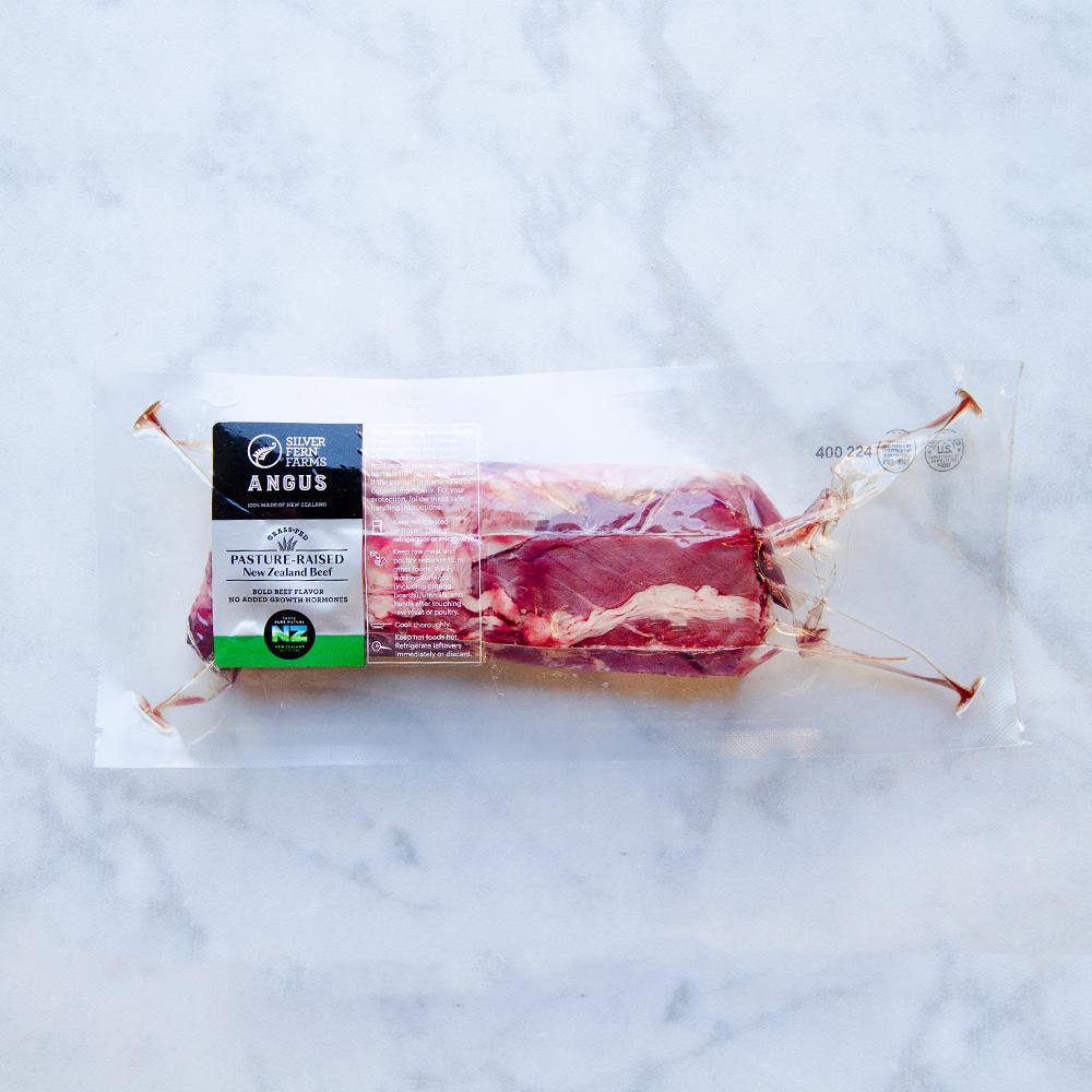 Raw New Zealand grass-fed Angus beef hanger steak in a vacuum sealed pack on a white marble slab