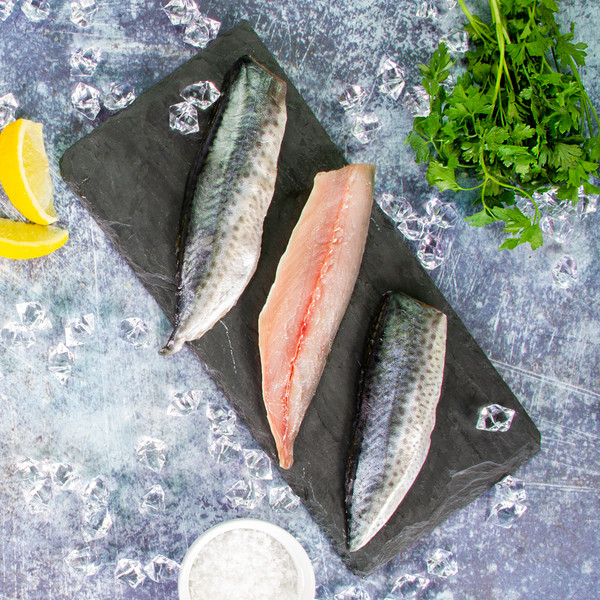 Raw Spanish mackerel fillets with salt, lemon & parsley