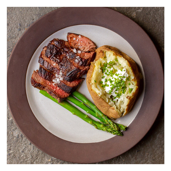Grilled bavette steak with asparagus & baked potato with sour cream & chives
