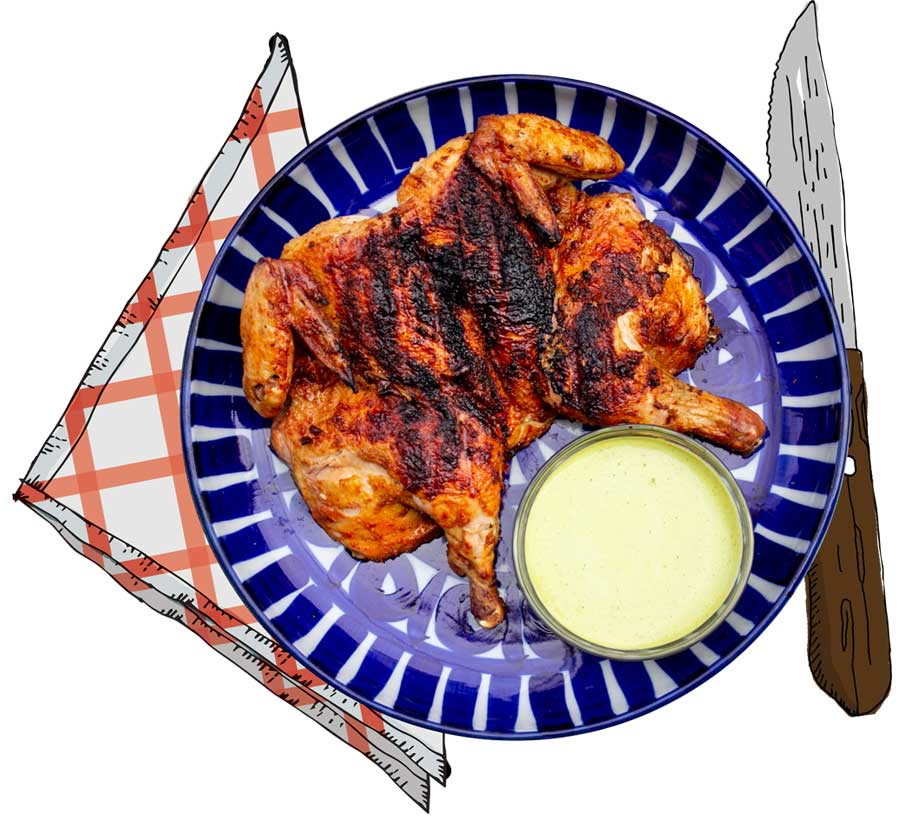 grilled chicken with sauce, knife, napkin